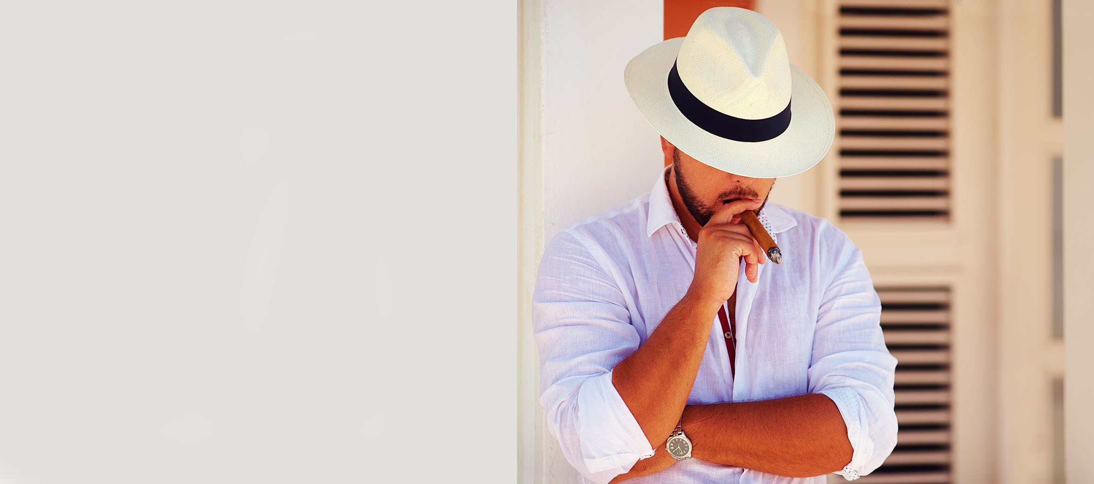 Latin man in the Caribbean wearing a Montecristi Fedora Classic Panama Hat