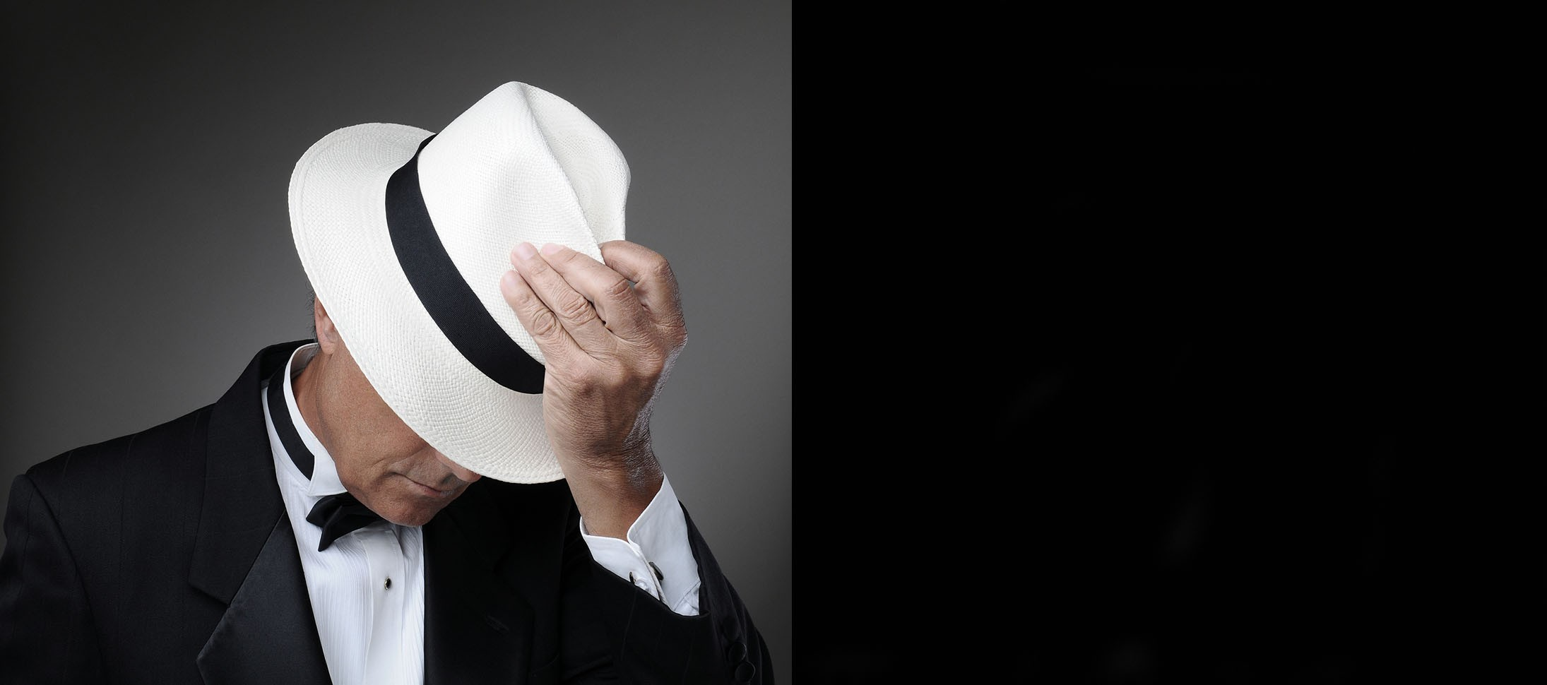 Middle age man with a white Cuenca Fedora Panama Hat